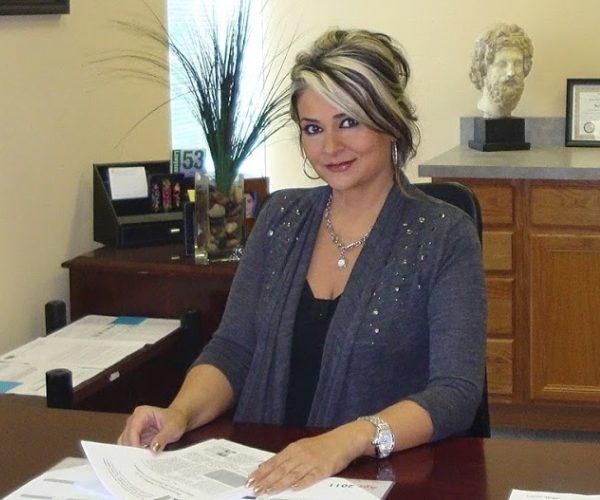 Della Partovi, Office Manager